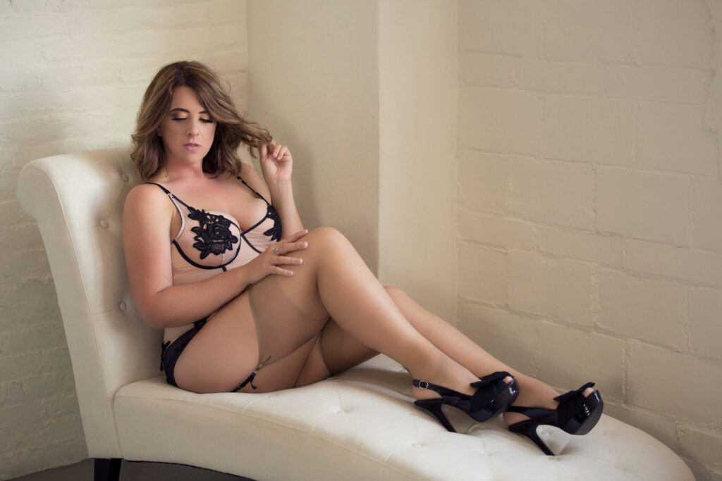 Sitting boudoir pose in nude and black bodysuit. Classy, Timeless, and Beautiful boudoir photography. See more at boudoirbytracylynn.com